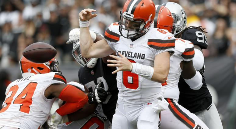 leveland Browns quarterback Baker Mayfield (6) has the ball knocked out of his hands by Oakland Raiders defensive tackle Maurice Hurst (73) in the third quarter at Oakland Coliseum