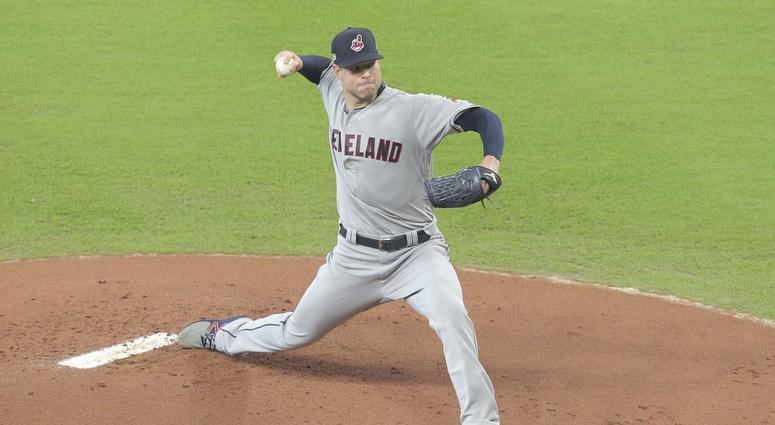 Oct 5, 2018; Houston, TX, USA; Cleveland Indians starting pitcher Corey Kluber (28) delivers a pitch during the first inning in game one of the 2018 ALDS playoff baseball series against the Houston Astros at Minute Maid Park. Mandatory Credit: Erik Willia