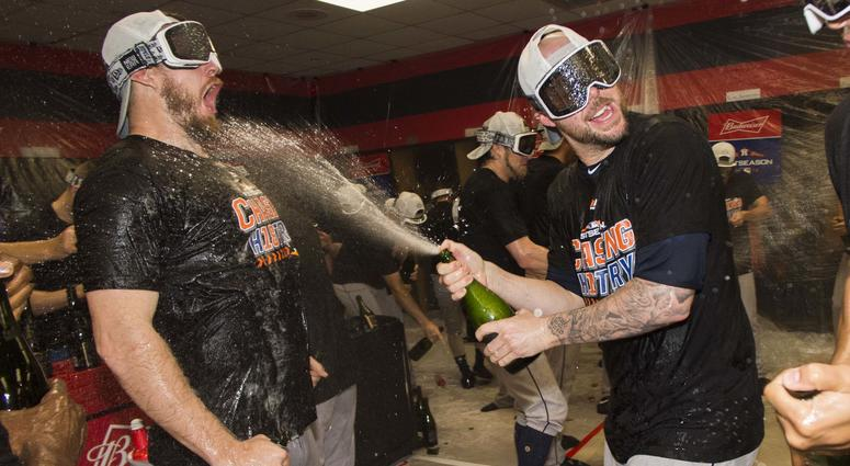 Oct 8, 2018; Cleveland, OH, USA; Members of the Houston Astros celebrate in the locker room after game three of the 2018 ALDS playoff baseball series against the Cleveland Indians at Progressive Field.
