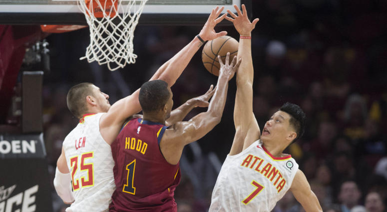 Oct 21, 2018; Cleveland, OH, USA; Atlanta Hawks center Alex Len (25) and guard Jeremy Lin (7) block the shot of Cleveland Cavaliers guard Rodney Hood (1) during the first half at Quicken Loans Arena.