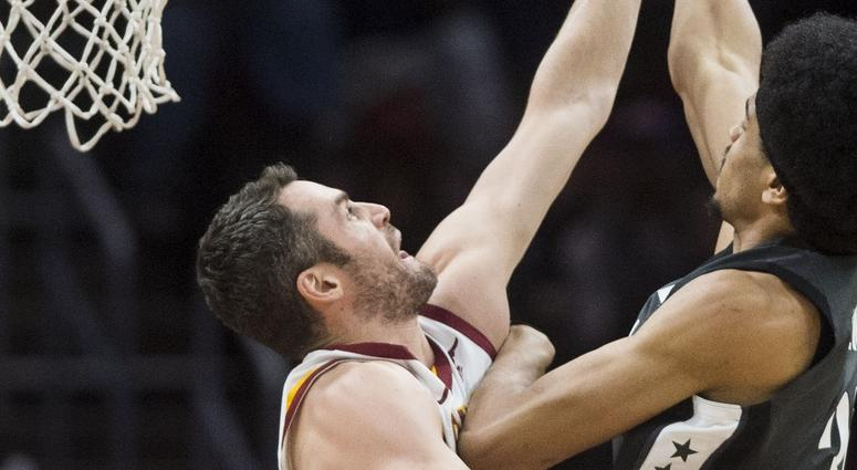 Cleveland Cavaliers forward Kevin Love (0) goes for the block on the shot of Brooklyn Nets center Jarrett Allen (31) during the first quarter at Quicken Loans Arena.