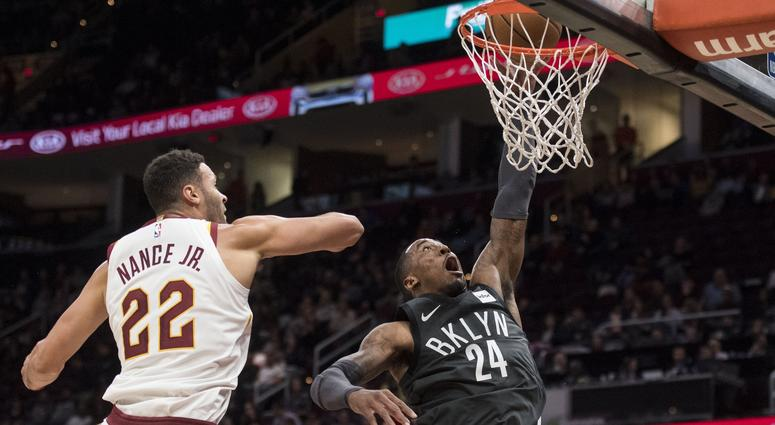 Brooklyn Nets forward Rondae Hollis-Jefferson (24) drives to the basket against Cleveland Cavaliers forward Larry Nance Jr. (22) during the second half at Quicken Loans Arena.