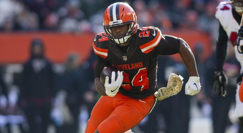 Cleveland Browns running back Nick Chubb (24) runs the ball for a first down against the Atlanta Falcons during the second quarter at FirstEnergy Stadium.