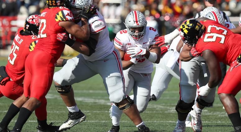 Ohio State Buckeyes running back J.K. Dobbins (2) runs for a gain against the Maryland Terrapins at Capital One Field at Maryland Stadium.