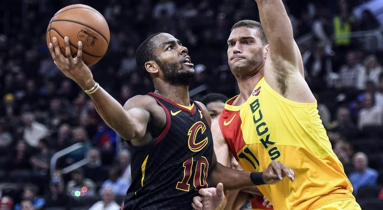 Dec 10, 2018; Milwaukee, WI, USA; Cleveland Cavaliers guard Alec Burks (10) takes a shot against Milwaukee Bucks center Brook Lopez (11) in the third quarter at the Fiserv Forum. Mandatory Credit: Benny Sieu-USA TODAY Sports