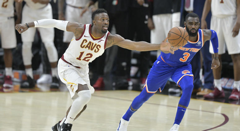 Dec 12, 2018; Cleveland, OH, USA; Cleveland Cavaliers guard David Nwaba (12) reaches for the ball against New York Knicks guard Tim Hardaway Jr. (3) in the final seconds of the fourth quarter at Quicken Loans Arena. Mandatory Credit: David Richard-USA TOD