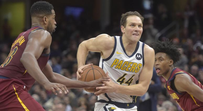 Jan 8, 2019; Cleveland, OH, USA; Indiana Pacers forward Bojan Bogdanovic (44) drives between Cleveland Cavaliers center Tristan Thompson (13) and guard Collin Sexton (right) in the second quarter at Quicken Loans Arena. Mandatory Credit: David Richard-USA