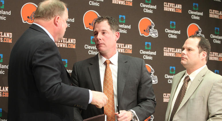 File: Browns President Mike Holmgren, left, new head coach Pat Shurmur, middle, and General Manager Tom Heckert, right, speak together after a news conference where Shurmur was presented to the media at the Browns' training facility in Berea, Ohio.