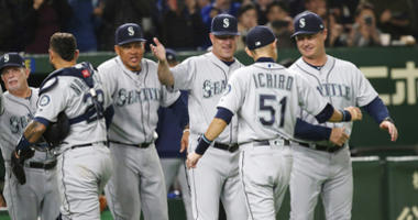Seattle Mariners right fielder Ichiro Suzuki (51) celebrates with teammates after defeating the Oakland Athletics 9-7 in Game 1 of their Major League opening series baseball game at Tokyo Dome in Tokyo, Wednesday, March 20, 2019. (AP Photo/Koji Sasahara)