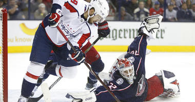 Columbus Blue Jackets' Sergei Bobrovsky, right, of Russia, makes a save against Washington Capitals' Chandler Stephenson during Game 4 of an NHL first-round hockey playoff series Thursday, April 19, 2018, in Columbus, Ohio. (AP Photo/Jay LaPrete)