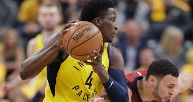 Indiana Pacers' Victor Oladipo (4) grabs a loose ball next to Cleveland Cavaliers' Larry Nance Jr. during the first half of Game 3 of a first-round NBA basketball playoff series Friday, April 20, 2018, in Indianapolis