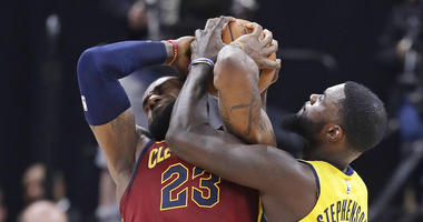 Cleveland Cavaliers' LeBron James (23) is tied up by Indiana Pacers' Lance Stephenson during the second half of Game 4 of a first-round NBA basketball playoff series, Sunday, April 22, 2018, in Indianapolis. Cleveland won 104-100. (AP Photo/Darron Cumming