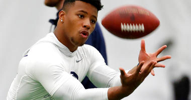 File-This March 20, 2018, file photo shows running back Saquon Barkley catching a football during Penn State NFL football Pro Day in State College, Pa. Barkley is the best player in this year's draft. Yet he might not go in the first handful of picks Thur