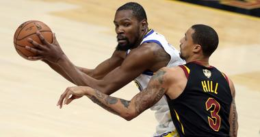 Golden State Warriors' Kevin Durant is defended by Cleveland Cavaliers' George Hill during the second half of Game 3 of basketball's NBA Finals, Wednesday, June 6, 2018, in Cleveland.