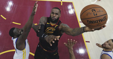 Cleveland Cavaliers' LeBron James shoots against Golden State Warriors' Draymond Green during the first half of Game 3 of basketball's NBA Finals, Wednesday, June 6, 2018, in Cleveland.