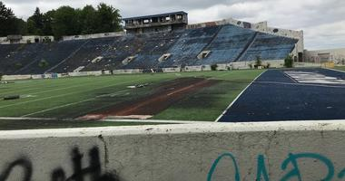 In this June 6, 2018 photo, the abandoned Akron Rubber Bowl stadium is pictured in Akron, Ohio. Part of the historic stadium is being torn down starting next week because it's a public health hazard.