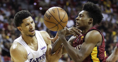 Los Angeles Lakers' Josh Hart, left, and Cleveland Cavaliers' Collin Sexton battle for the ball during the second half of an NBA summer league basketball game, Monday, July 16, 2018, in Las Vegas.