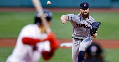 Cleveland Indians starting pitcher Corey Kluber delivers during the first inning of a baseball game against the Boston Red Sox at Fenway Park in Boston, Monday, Aug. 20, 2018.