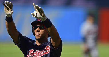 Cleveland Indians' Michael Brantley celebrates after hitting a solo home run in the first inning of a baseball game against the Detroit Tigers, Saturday, Sept.15, 2018, in Cleveland.