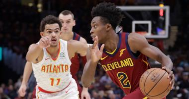 Cleveland Cavaliers' Collin Sexton (2) drives past Atlanta Hawks' Trae Young (11) in the first half of an NBA basketball game, Sunday, Oct. 21, 2018, in Cleveland.