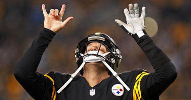 Pittsburgh Steelers quarterback Ben Roethlisberger (7) celebrates a touchdown pass to Antonio Brown during the first half of an NFL football game against the Carolina Panthers in Pittsburgh, Thursday, Nov. 8, 2018.
