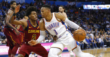 Oklahoma City Thunder guard Russell Westbrook (0) drives to the basket around Cleveland Cavaliers guard Collin Sexton (2) during the second half of an NBA basketball game in Oklahoma City, Wednesday, Nov. 28, 2018. Oklahoma City won 100-83. (AP Photo/Alon