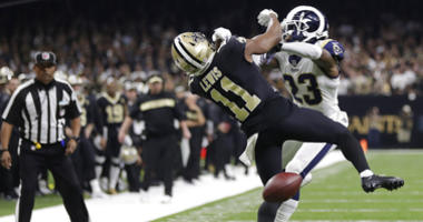 New Orleans Saints wide receiver Tommylee Lewis (11) works for a coach against Los Angeles Rams defensive back Nickell Robey-Coleman (23) during the second half the NFL football NFC championship game Sunday, Jan. 20, 2019, in New Orleans. The Rams won 26-
