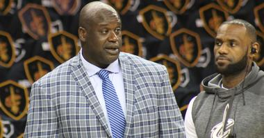 Shaquille O'Neal and LeBron James talk prior to a game at Quicken Loans Arena.