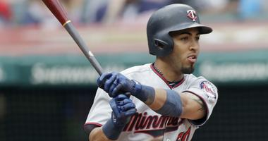 Minnesota Twins' Eddie Rosario hits an RBI-single off Cleveland Indians relief pitcher Tyler Olson in the sixth inning of a baseball game, Saturday, June 16, 2018, in Cleveland. Ehire Adrianza scored on the play.