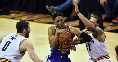 Jun 9, 2017; Cleveland, OH, USA; Golden State Warriors guard Patrick McCaw (0) drives to the basket against Cleveland Cavaliers guard Deron Williams (31) and forward Kevin Love (0) during the fourth quarter in game four of the Finals for the 2017 NBA Play