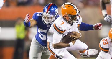 Cleveland Browns quarterback DeShone Kizer (7) is sacked by New York Giants defensive end Olivier Vernon (54) during the second quarter at FirstEnergy Stadium.