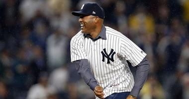 October 9, 2017; Bronx, NY, USA; New York Yankees former pitcher Mariano Rivera throws out the ceremonial first pitch before the Yankees play the Cleveland Indians in game four of the 2017 ALDS playoff baseball series at Yankee Stadium. Mandatory Credit: