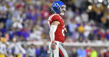 Shea Patterson (20) walks off the field after throwing an interception during the fourth quarter against the LSU Tigers at Vaught-Hemingway Stadium.