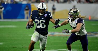 Penn State Nittany Lions running back Saquon Barkley (26) runs the ball as Washington Huskies linebacker Ben Burr-Kirven (25) defends during the second half during the 2017 Fiesta Bow