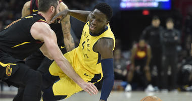 Apr 15, 2018; Cleveland, OH, USA; Indiana Pacers guard Victor Oladipo (4) collides with Cleveland Cavaliers center Kevin Love (0) in the first quarter in game one of the first round of the 2018 NBA Playoffs at Quicken Loans Arena.