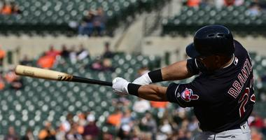 Apr 21, 2018; Baltimore, MD, USA; Cleveland Indians left fielder Michael Brantley (23) hits a sacrifice fly scoring second baseman Jason Kipnis (not pictured) during the first inning against the Baltimore Orioles at Oriole Park at Camden Yards.