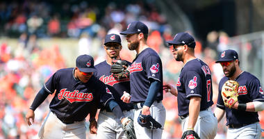 Apr 22, 2018; Baltimore, MD, USA; Cleveland Indians pitcher Corey Kluber (28) is congratulated by teammates while being removed from the game in the eighth inning against the Baltimore Orioles at Oriole Park at Camden Yards.