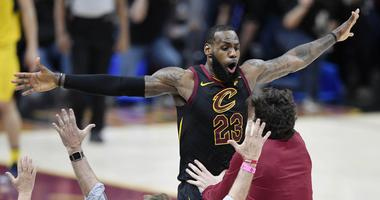 Cavaliers forward LeBron James (23) celebrates his game-winning three-point basket in the fourth quarter against the Indiana Pacers in game five of the first round of the 2018 NBA Playoffs