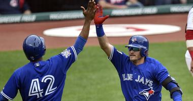 Toronto Blue Jays third baseman Josh Donaldson (20) celebrates his solo home run in the sixth inning against the Cleveland Indians at Progressive Field.