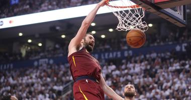 May 3, 2018; Toronto, Ontario, CAN; Cleveland Cavaliers forward Kevin Love (0) dunks the ball against the Toronto Raptors in game two of the second round of the 2018 NBA Playoffs at Air Canada Centre. Mandatory Credit: Tom Szczerbowski-USA TODAY Sports