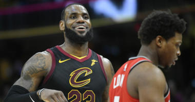 May 7, 2018; Cleveland, OH, USA; Cleveland Cavaliers forward LeBron James (23) reacts beside Toronto Raptors guard Kyle Lowry (7) in the third quarter in game four of the second round of the 2018 NBA Playoffs at Quicken Loans Arena.