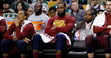 Cavaliers forward LeBron James (23) watches the action against the Boston Celtics from the bench during the fourth quarter in game one of the Eastern conference finals of the 2018 NBA Playoffs at TD Garden