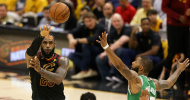 Cavaliers forward LeBron James (23) passes the ball in front of Boston Celtics forward Marcus Morris (13) during the first quarter in game three of the Eastern conference finals of the 2018 NBA Playoffs at Quicken Loans Arena.
