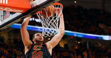 Cavaliers forward Larry Nance Jr. (22) dunks and scores in front of Boston Celtics forward Al Horford (42) in game three of the Eastern conference finals of the 2018 NBA Playoffs at Quicken Loans Arena.