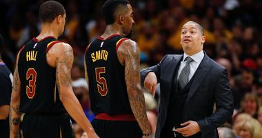 Cavaliers head coach Tyronn Lue talks with guard JR Smith (5) during the second half against the Boston Celtics in game three of the Eastern conference finals of the 2018 NBA Playoffs at Quicken Loans Arena.