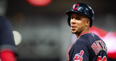May 25, 2018; Cleveland, OH, USA; Cleveland Indians Michael Brantley (23) laughs with first base coach Sandy Alomar Jr. during the seventh inning against the Houston Astros at Progressive Field.