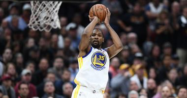 Golden State Warriors forward Kevin Durant (35) shoots against the Cleveland Cavaliers during the second quarter in game three of the 2018 NBA Finals at Quicken Loans Arena.