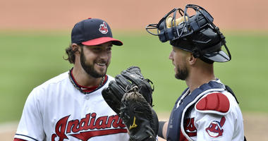 Jun 20, 2018; Cleveland, OH, USA; Cleveland Indians relief pitcher George Kontos (70) reacts with catcher Yan Gomes (7) in the eighth inning against the Chicago White Sox at Progressive Field.