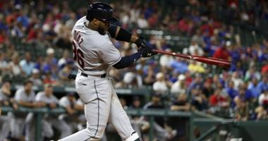 Cleveland Indians designated hitter Yandy Diaz (36) triples during the ninth inning against the Texas Rangers at Globe Life Park in Arlington.