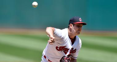 Jul 25, 2018; Cleveland, OH, USA; Cleveland Indians starting pitcher Trevor Bauer (47) delivers in the first inning against the Pittsburgh Pirates at Progressive Field.